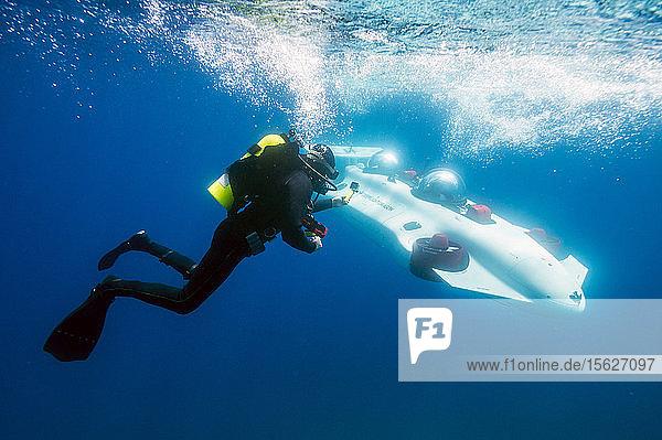 Photograph with scuba diver swimming near prototype personal submarine  Lake Tahoe  California  USA