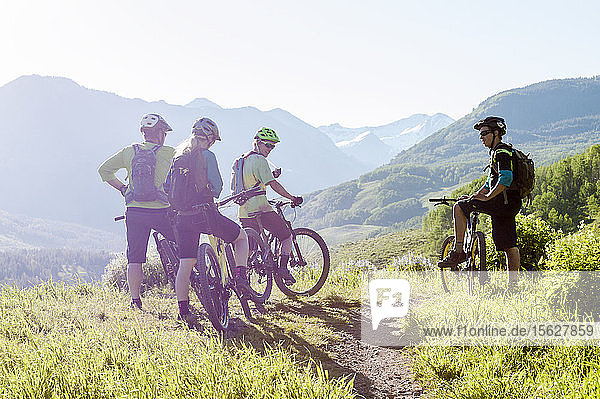 Group Of Mountain Bikers Taking A Break On Their Ride