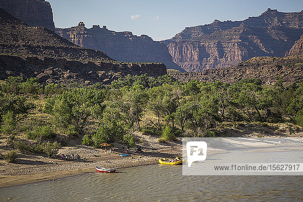 Distant view of camp and rafts on bank of Green River on Desolation/Gray Canyon section  Utah  USA