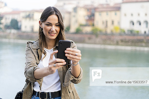 Young brunette woman using smartphone in Verona  Italy