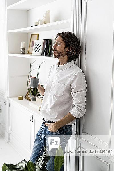Man having a coffee break at home