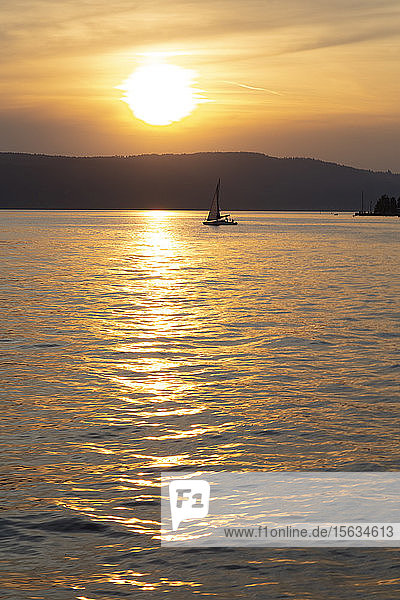 Silhouette sailboat sailing on Lake Constance against sky during sunset at Ãœberlingen  Germany