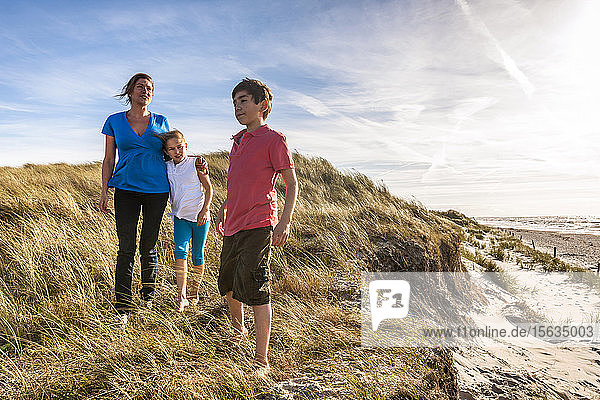 Mother with two children in a beach dune at the sea  Darss  Mecklenburg-Western Pomerania  Germany