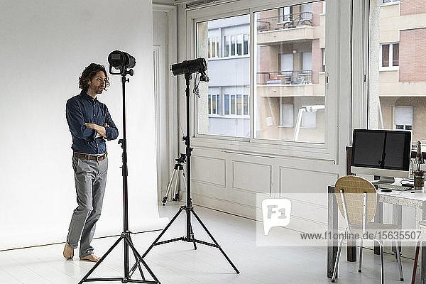 Photographer standing in his studio