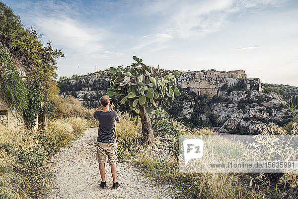 Hiker photographing cactus  Scicli  Sicily