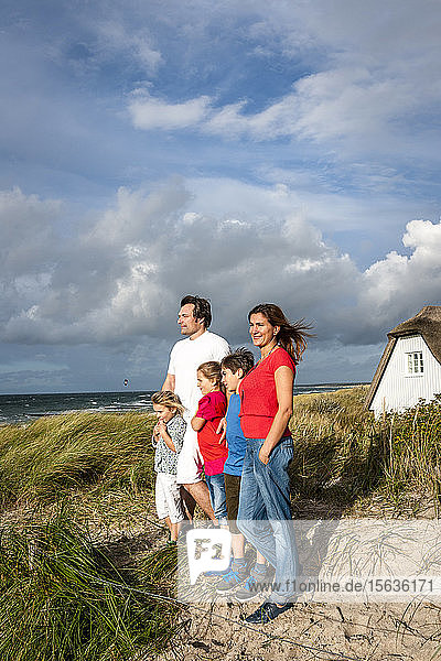 Family standing in a beach dune looking at view  Darss  Mecklenburg-Western Pomerania  Germany