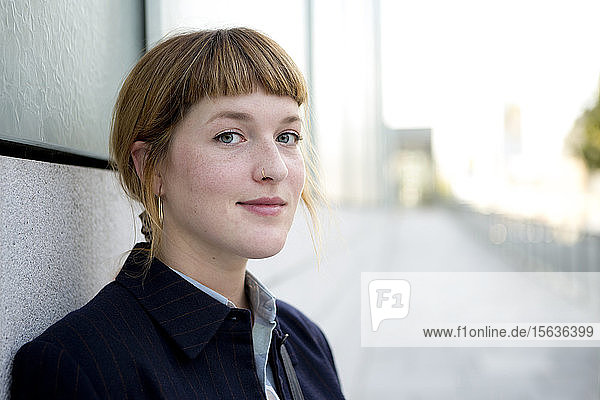 Portrait of strawberry blonde young woman with nose piercing