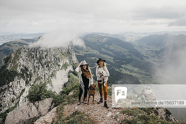 Two young women with dogs on viewpoint  Grosser Mythen  Switzerland