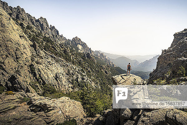 Female hiker standing on viewpoint  Aiguilles de Bavella  Corsica  France