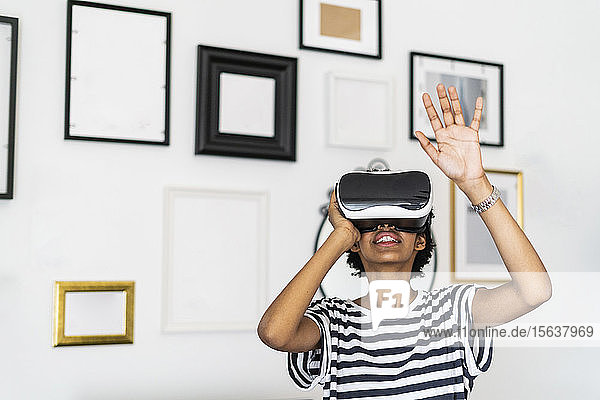 Young woman with VR glasses at home