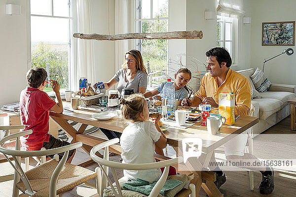 Family having breakfast at dining table