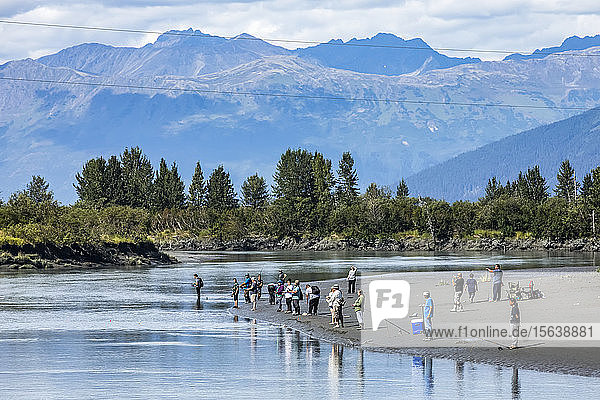 Silver salmon fishermen fish in Portage Creek in the Portage Valley  South of Anchorage  South-central Alaska; Alaska  United States of America