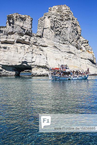 Tourists on tour boat in Kleftiko Bay; Milos Island  Cyclades  Greece