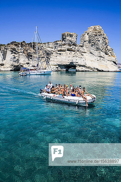 Tourists on catamaran tour boat in Kleftiko Bay; Milos Island  Cyclades  Greece