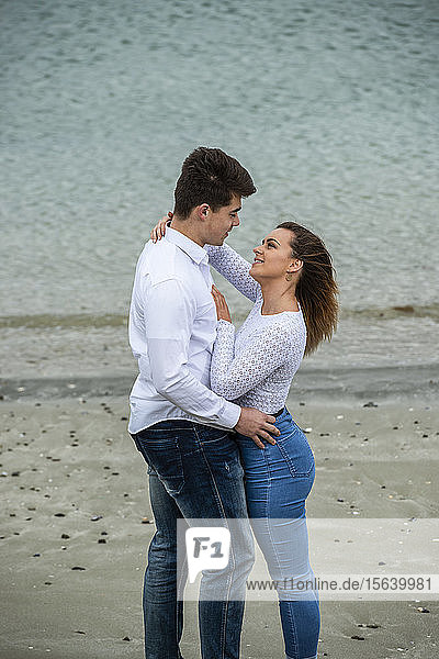 Portrait of a young couple showing affection; Wellington  North Island  New Zealand