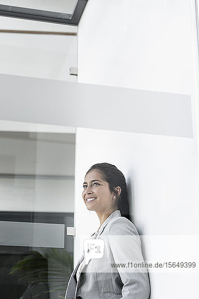 Portrait of young businesswoman in corridor of building