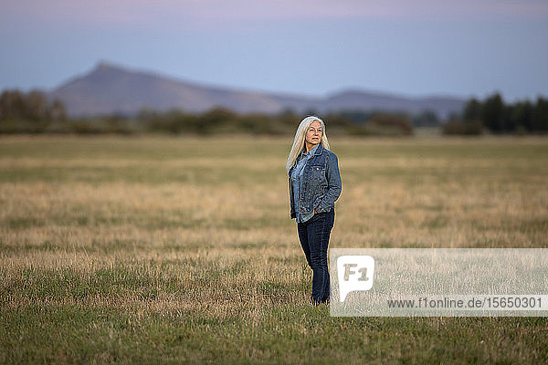 Woman in field in Picabo  Idaho  USA