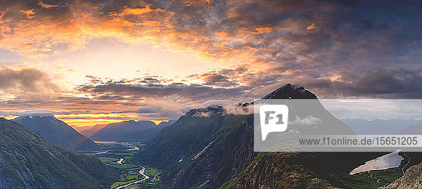 Fiery sky at sunset over Romsdalen and Venjesdalen mountains seen from Romsdalseggen Ridge  Andalsnes  More og Romsdal  Norway  Scandinavia