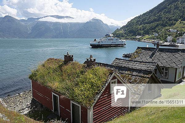 A ferry leaving the village of Utne on Hardanger Fjord  Vestlandet  Norway  Scandinavia