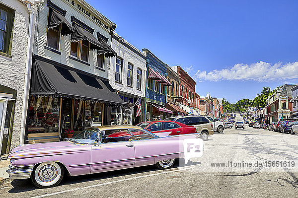 A pink 60s Cadillac in the historic old town of Weston  Missouri  United States of America  North America