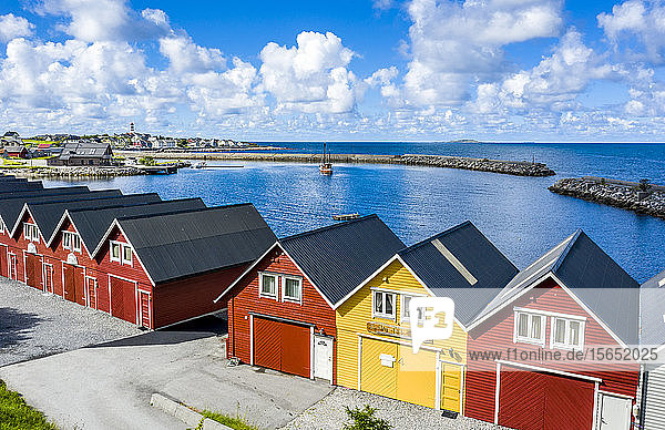 Traditional wood houses waterfront along the fjord  Alnes  Godoya Island  Alesund  More og Romsdal County  Norway  Scandinavia
