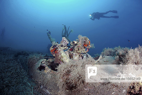 Diver at wrack of North American B25 Mitchell  Corsica