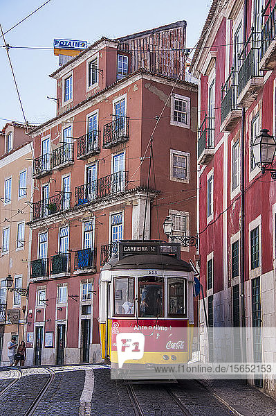 Tram passing in residential district of Alfama at Lisbon  Portugal