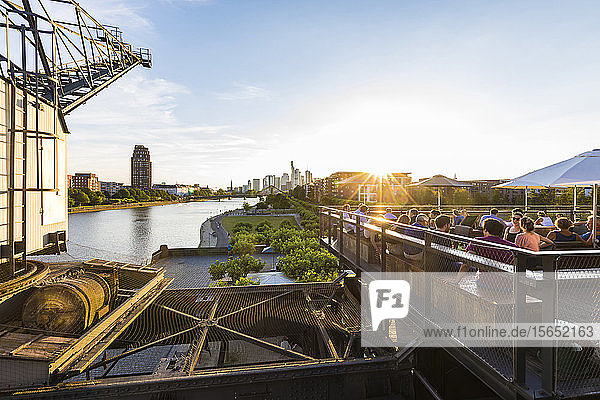 People on terrace of restaurant Oosten during sunset in Frankfurt  Germany