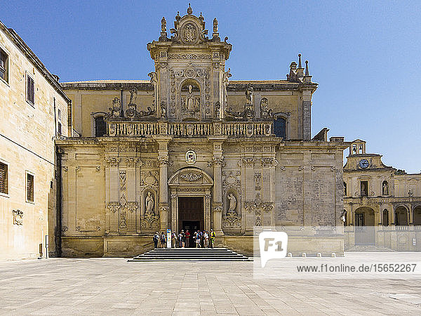 People entering Lecce Cathedral against clear blue sky during sunny day  Lecce  Italy