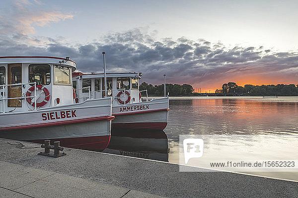 Germany  Hamburg  Passenger ships moored on lake Binnenalster at sunrise