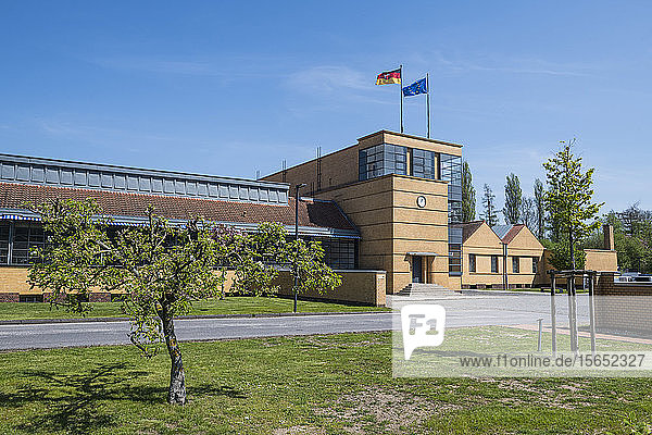 Low angle view of Fagus Factory against blue sky in city  Lower Saxony  Germany