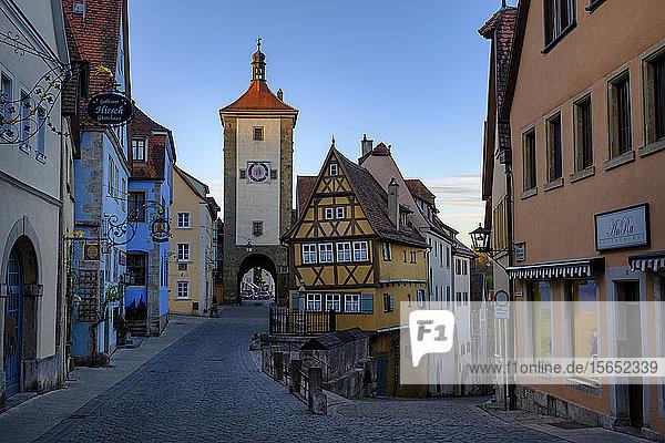 Kobolzeller Gate and houses against sky in Rothenburg  Germany