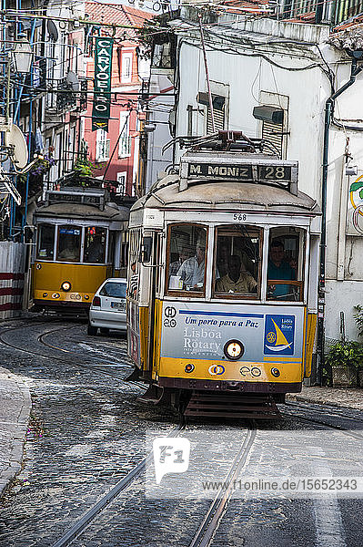Tram passing through old town street of Alfama  Lisbon