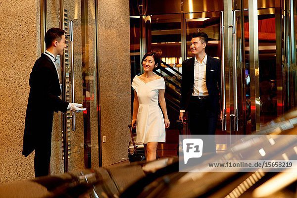 The young couple leave the luxury hotel