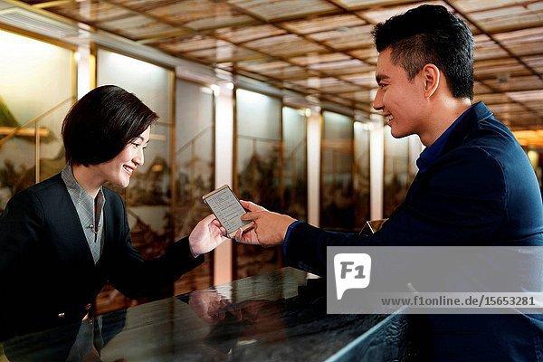 Business man for hotel registration