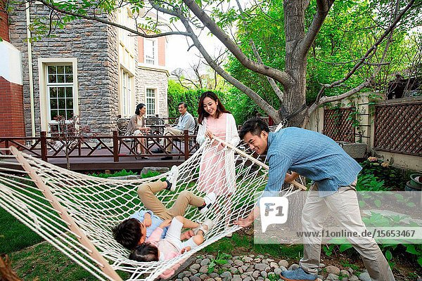 Happy family playing in the courtyard
