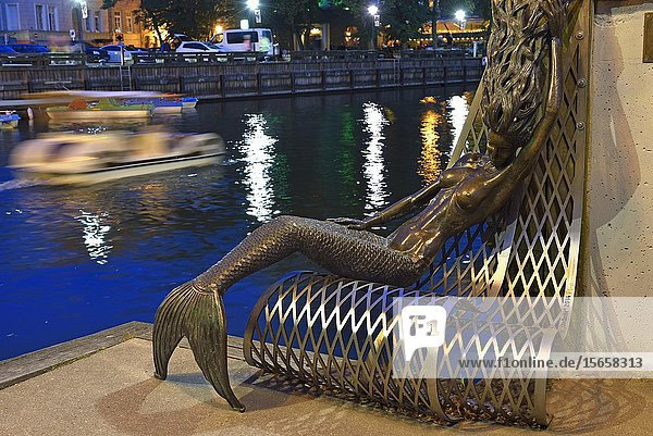 Siren bench on the embankment of the Dane River  old harbour of Klaipeda  port city on the Baltic Sea  Lithuania  Europe.