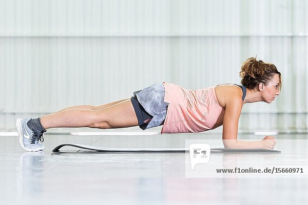 Young woman making core exercises. Plank.