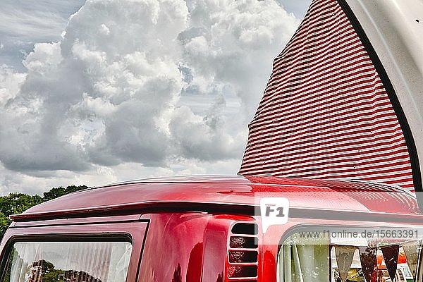 Red VW Camper van with red and white striped pop up roof open  Nottingham Transport Festival  Autokarna 2019  Wollaton Park  Nottingham  Nottinghamshire  East Midlands  United Kingdom
