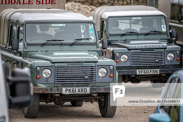 A pair of Land Rover defender parked at the Hawes auction house  Yorkshire  UK.