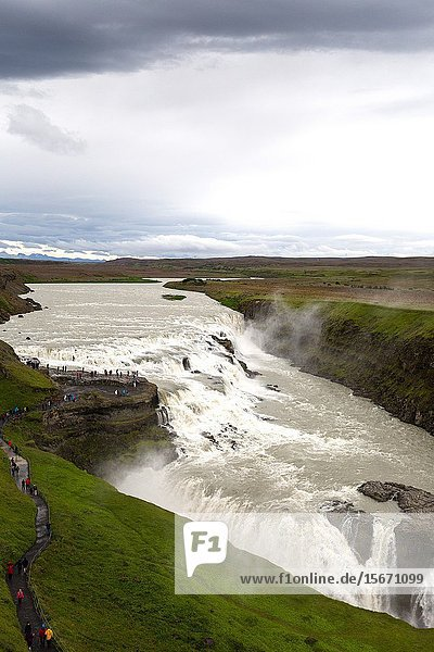 Tourists at the Gullfoss gorge. Iceland.
