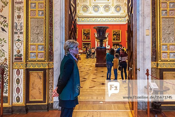 Old custodian in the Winter Palace in the State Hermitage Museum in St Petersburg  Russia.