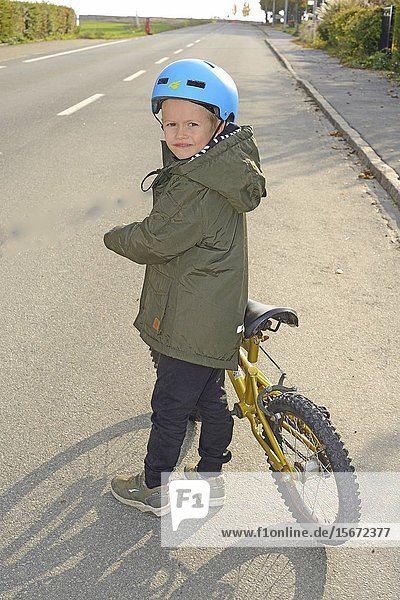 Little boy  6 years old with his bicycle on a street Ystad  Scania  Sweden.