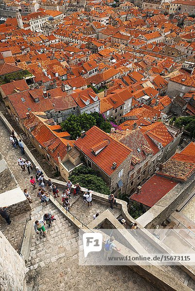 Red tile roofs and tourists on the ancient city wall above old town Dubrovnik  Dalmatian Coast  Croatia.