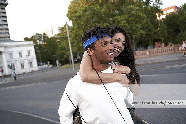 Young couple piggybacking. Frankfurt am Main  Germany.