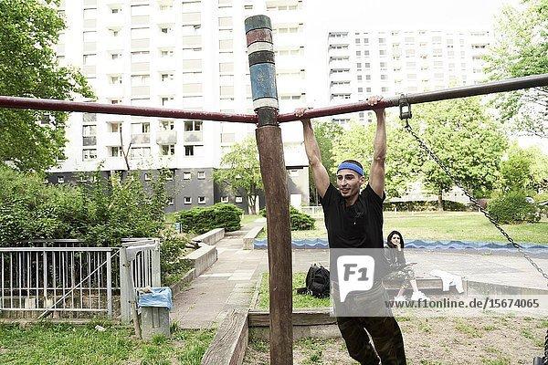 Young man doing acrobatics in park. Frankfurt am Main  Germany.