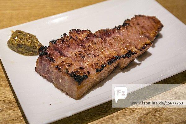 Grilled of thick bacon with Sake lees. EN Japanese Brasserie. Shinagawa. Tokyo. Japan.