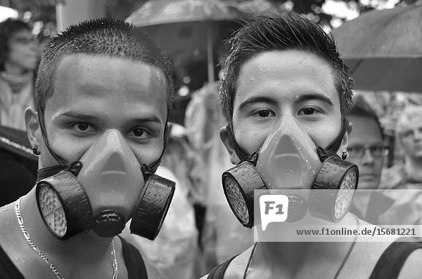 Switzerland: Two Ravers with gasmasks at the Streetparade in Zürich.