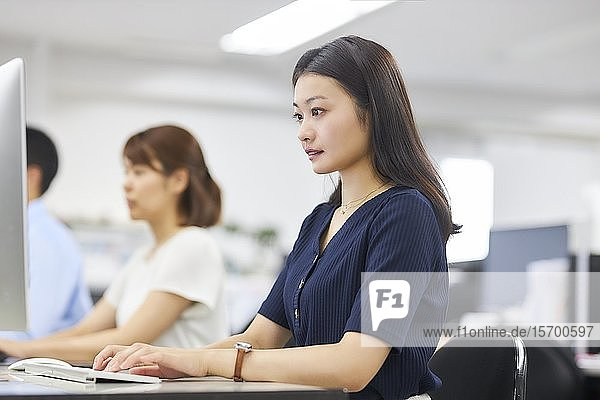 Japanese woman working in the office