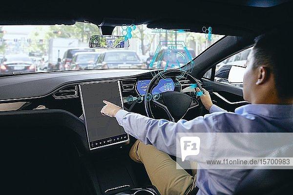 Japanese man in self driving car